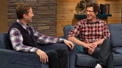 Andy Samberg Wears a Plaid Shirt & Glasses